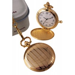 1T. Pocket watch in golden metal with bars pattern. In metal case